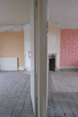 The bedrooms with wallpaper removed and old fireplace gone. Ready to be squared off!