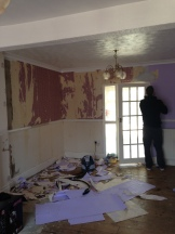 We started on the lounge and revealed a dark red wallpaper under the bright lilac.