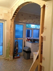 The arch in the kitchen on its way out to open the space up. It made a big difference.